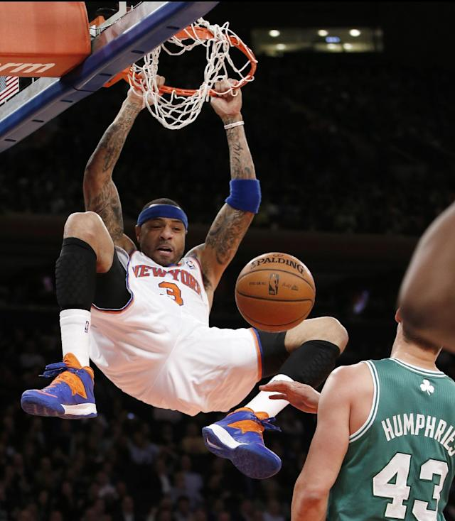 New York Knicks forward Kenyon Martin (3) dunks in front of Boston Celtics center Kris Humphries (43) in the first half of an NBA basketball game at Madison Square Garden in New York, Tuesday, Jan. 28, 2014. (AP Photo/Kathy Willens)