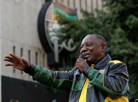 South African President Cyril Ramaphosa addresses supporters of his ruling African National Congress (ANC) at an election victory rally  in Johannesburg