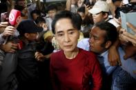 FILE PHOTO: Myanmar's National League for Democracy party leader Aung San Suu Kyi arrives to cast her ballot during the general election in Yangon