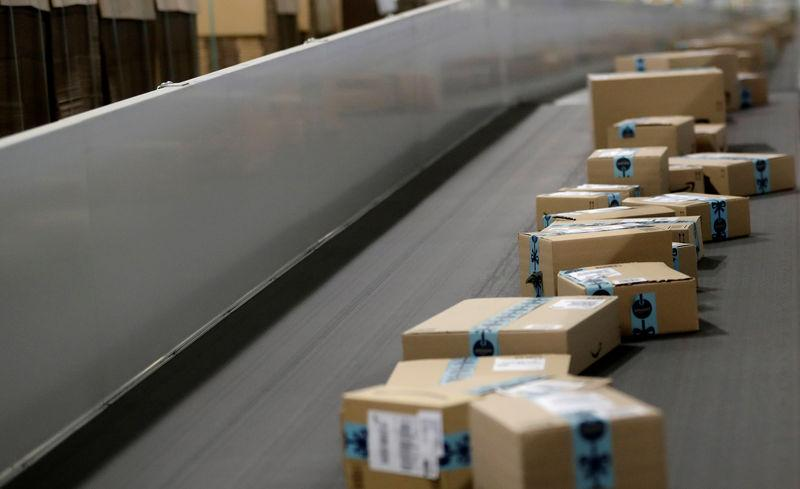 FILE PHOTO: Packages are transported on a conveyor belt at the Amazon fulfillment center in the village of Dobroviz, near Prague