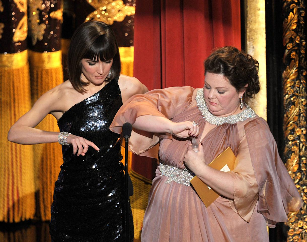 Rose Byrne and Melissa McCarthy on stage during the 84th Annual Academy Awards in Hollywood, CA.