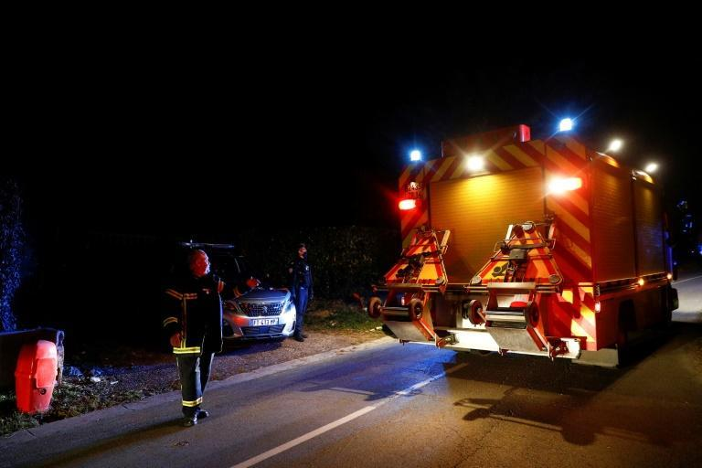Emergency workers arrive at the scene of a helicopter crash in northwest France in which Olivier Dassault died
