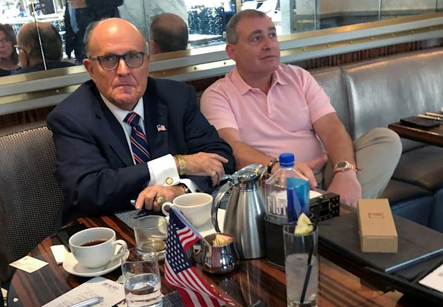 Trump's personal lawyer Rudy Giuliani with Ukrainian-American businessman Lev Parnas at the Trump International Hotel in Washington, Sept. 20, 2019. (Photo: Aram Roston/Reuters)