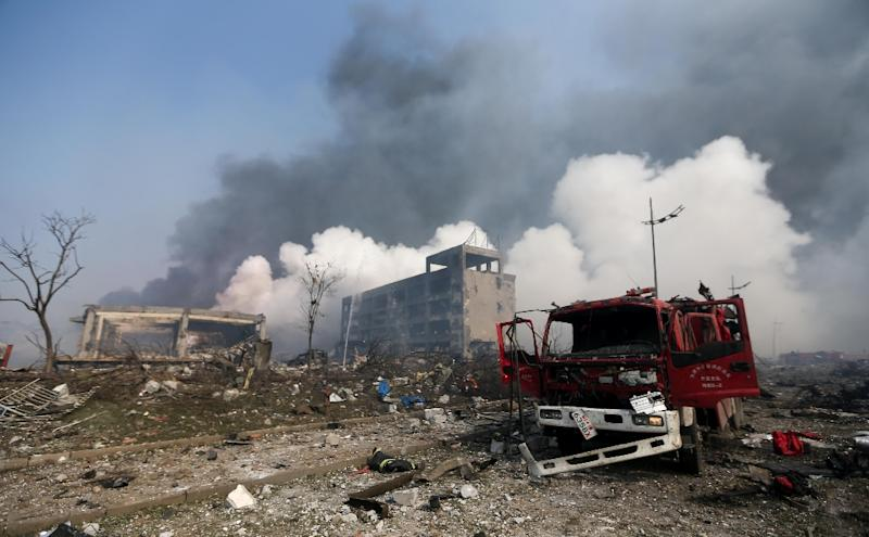 A damaged fire truck is seen at the site of the massive explosions in Tianjin on August 13, 2015 (AFP Photo/)