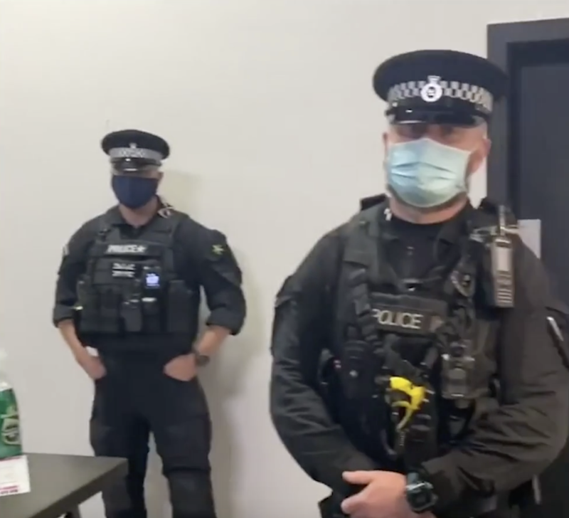 Police are seen in the video as officers ordered the gym to shut. (Instagram/nickcapo_)