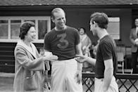 <p>With the Queen and Prince Charles, receiving a trophy after a polo match.</p>