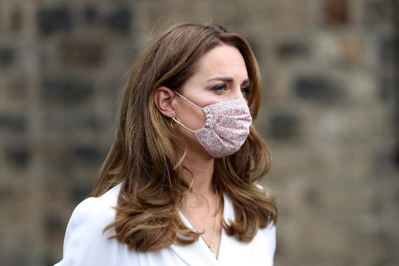 EMBARGOED TO 2200 TUESDAY AUGUST 4 The Duchess of Cambridge, wearing a face mask, during a visit to Baby Basic UK & Baby Basics Sheffield. Baby Basics is a volunteer project supporting families in need struggling to provide for their newborns.