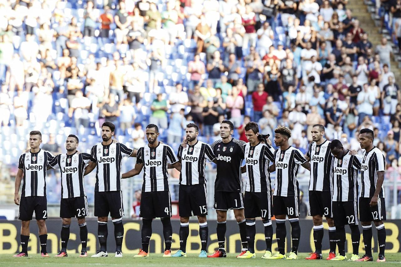 Juventus' players observe a minute of silence to honor the victims of Wednesday's earthquake that hit central Italy, prior to a Serie A soccer match between Lazio and Juventus at Rome's Olympic stadium, Saturday, Aug. 27, 2016. (Angelo Carconi/ANSA via AP)