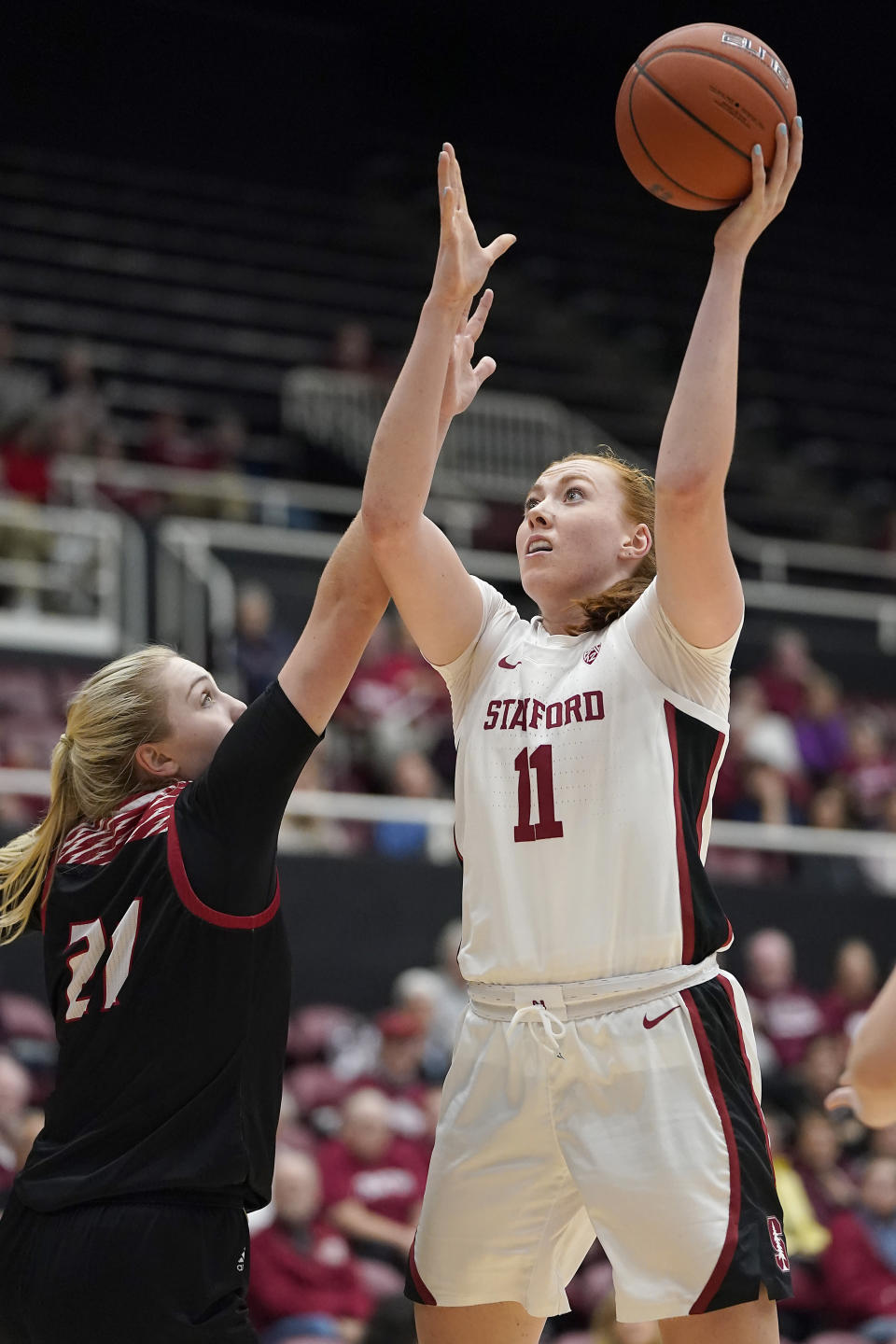 Stanford forward Ashten Prechtel (11) shoots over Eastern Washington forward Milly Knowles (21) during the first half of an NCAA college basketball game Tuesday, Nov. 5, 2019, in Stanford, Calif. (AP Photo/Tony Avelar)