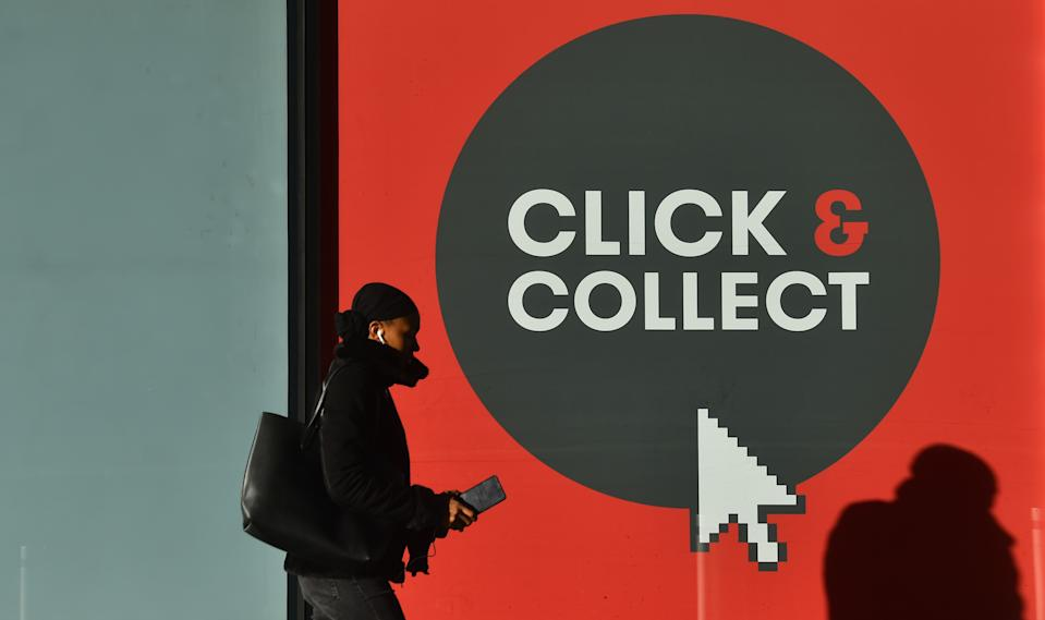 BIRMINGHAM, ENGLAND - JANUARY 05: : A lady walks past a click and collect sign Birmingham during the nationwide lockdown on January 05, 2021 in Birmingham, England. British Prime Minister made a national television address on Monday evening  announcing England is to enter its third lockdown of the covid-19 pandemic. On Monday, the UK recorded more than 50,000 new confirmed covid-19 cases for the seventh day in a row. (Photo by Nathan Stirk/Getty Images)