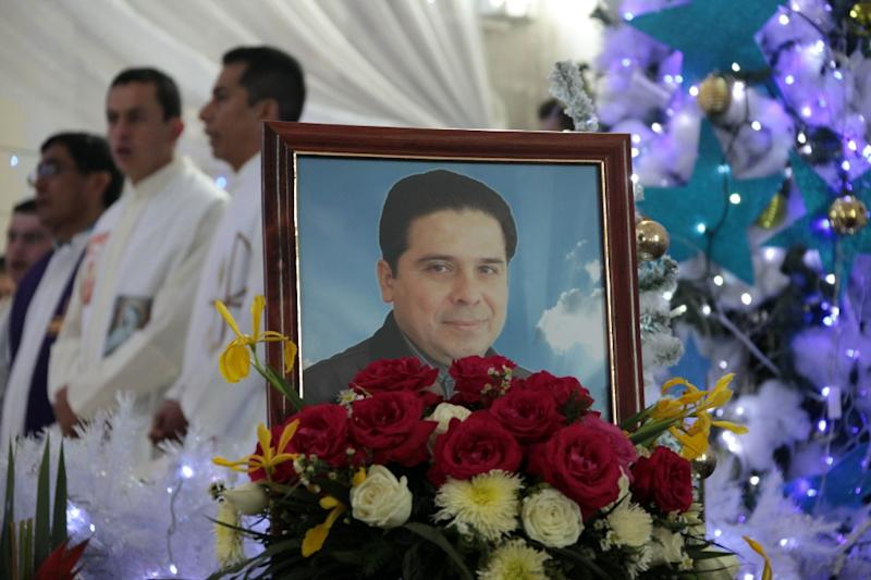 A portrait of priest Gregorio Lopez at his funeral in Altamirano, Guerrero State, Mexico, on December 26, 2014 after he was kidnapped and killed (AFP Photo/Pablo Spencer)