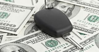 Car key on money copyright Nata-Lia/Shutterstock.com