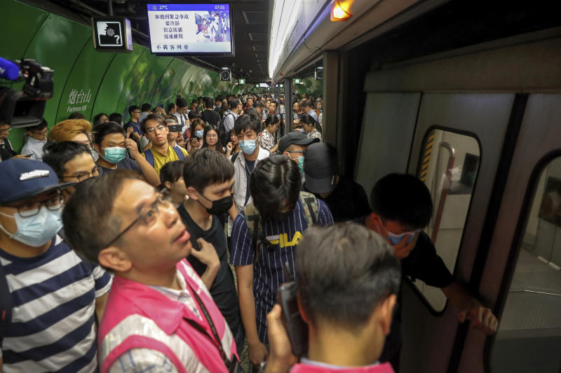 Protesters block train doors at Fortress Hill MTR station in Hong Kong.