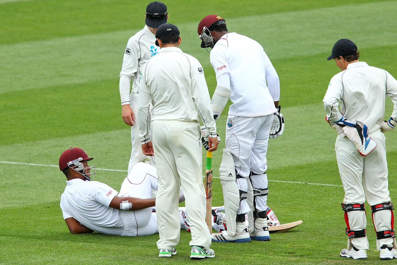 WELLINGTON, NEW ZEALAND - DECEMBER 13:  Kieran Powell of the West Indies goes down injured during day three of the Second Test match between New Zealand and the West Indies at Basin Reserve on December 13, 2013 in Wellington, New Zealand.  (Photo by Hagen Hopkins/Getty Images)