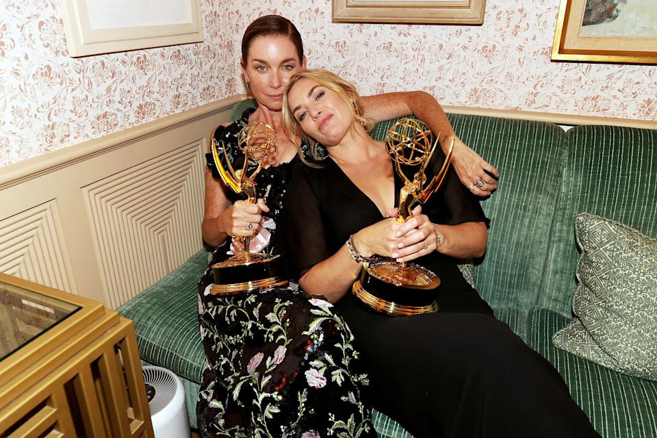 <p><em>Mare of Easttown</em>'s Julia Nicholson and Kate Winslet have a moment with their Emmy statuettes on Sept. 19 at the HBO and HBO Max Post-Emmys Reception at San Vicente Bungalows in West Hollywood.</p>