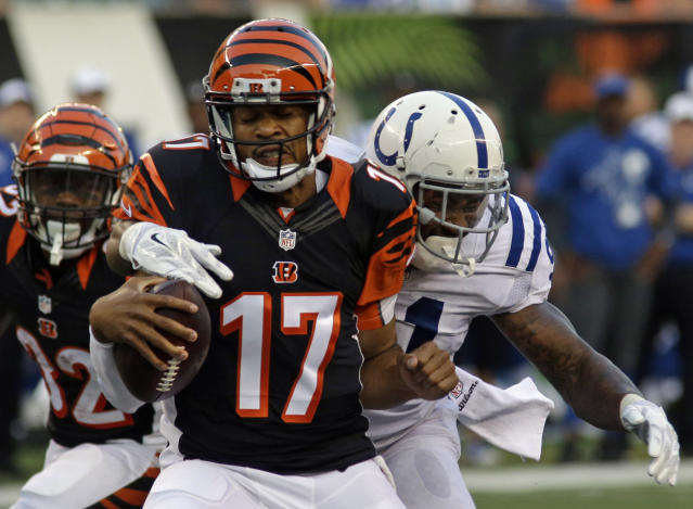 Cincinnati Bengals quarterback Jason Campbell (17) is sacked by Indianapolis Colts defensive end Jonathan Newsome in the first half of an NFL preseason football game, Thursday, Aug. 28, 2014, in Cincinnati. (AP Photo/Tom Uhlman)
