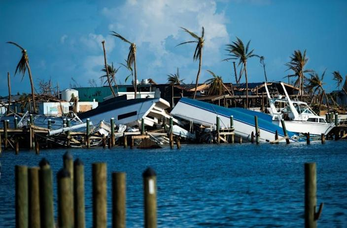 Destroyed boats are pushed up against the pier in the aftermath of Hurricane Dorian in Treasure Cay on Abaco Island, Bahamas (AFP Photo/Andrew CABALLERO-REYNOLDS)