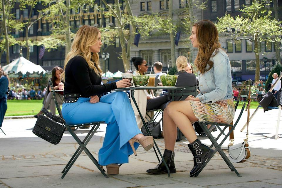 """Hilary Duff and Sutton Foster sit outside at a table across from each other, from """"Friends With Benefits"""" (Season 6, Episode 607)"""