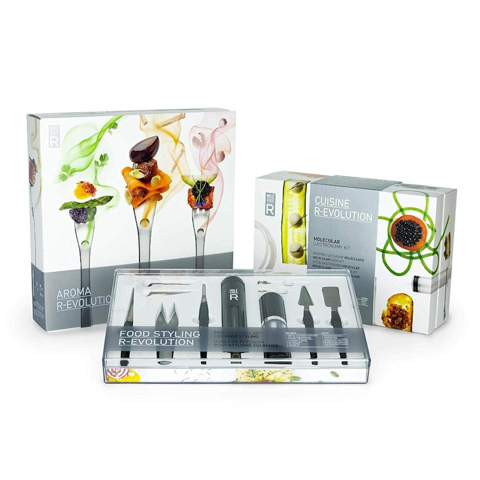 """<p>Get your inner scientist on with the <a href=""""https://www.popsugar.com/buy/Molecule-R-Triple-Skill-Molecular-Gastronomy-Set-527896?p_name=Molecule-R%20Triple%20Skill%20Molecular%20Gastronomy%20Set&retailer=amazon.com&pid=527896&price=100&evar1=yum%3Aus&evar9=42776771&evar98=https%3A%2F%2Fwww.popsugar.com%2Ffood%2Fphoto-gallery%2F42776771%2Fimage%2F42777745%2FMolecule-R-Triple-Skill-Molecular-Gastronomy-Set&list1=holiday%2Cgift%20guide%2Ckitchen%20tools%2Choliday%20food&prop13=api&pdata=1"""" rel=""""nofollow"""" data-shoppable-link=""""1"""" target=""""_blank"""" class=""""ga-track"""" data-ga-category=""""Related"""" data-ga-label=""""https://www.amazon.com/Molecule-R-Molecular-Gastronomy-Volatile-Flavoring/dp/B07JKHKPQ2/ref=sr_1_1?keywords=molecular+styling+kit+cookbook&amp;qid=1575602474&amp;sr=8-1"""" data-ga-action=""""In-Line Links"""">Molecule-R Triple Skill Molecular Gastronomy Set</a> ($100), which not only teaches you the molecular gastronomy but also comes at a low price, which enables you to dabble without tricking out your entire kitchen.</p>"""
