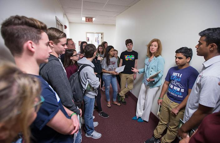 <p>Florida Rep. Kristin Jacobs talks with student survivors from Marjory Stoneman Douglas High School in the hallway at the Florida Capitol in Tallahassee, Fla., Feb 21, 2018. The students from Marjory Stoneman Douglas High School are in town to lobby the Florida Legislature after a shooting that left 17 dead at their school. (Photo: Mark Wallheiser/AP) </p>