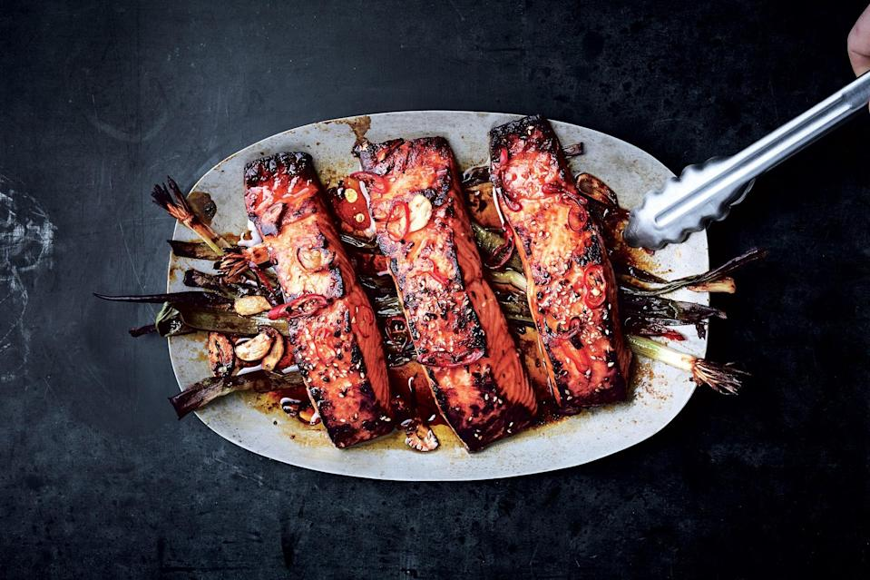 "A honey-soy glaze and a turn under the broiler (or on top of the grill) give this salmon a sweet and savory char. <a href=""https://www.epicurious.com/recipes/food/views/broiled-salmon-with-scallions-and-sesame?mbid=synd_yahoo_rss"" rel=""nofollow noopener"" target=""_blank"" data-ylk=""slk:See recipe."" class=""link rapid-noclick-resp"">See recipe.</a>"