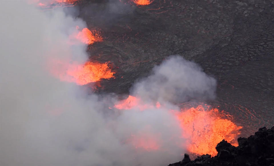 This photo provided by USGS shows the eruption within in Kilauea volcano's Halemaumau crater west vent on Wednesday, Sept. 29, 2021. One of the most active volcanos on Earth is erupting on Hawaii's Big Island. (USGS via AP)