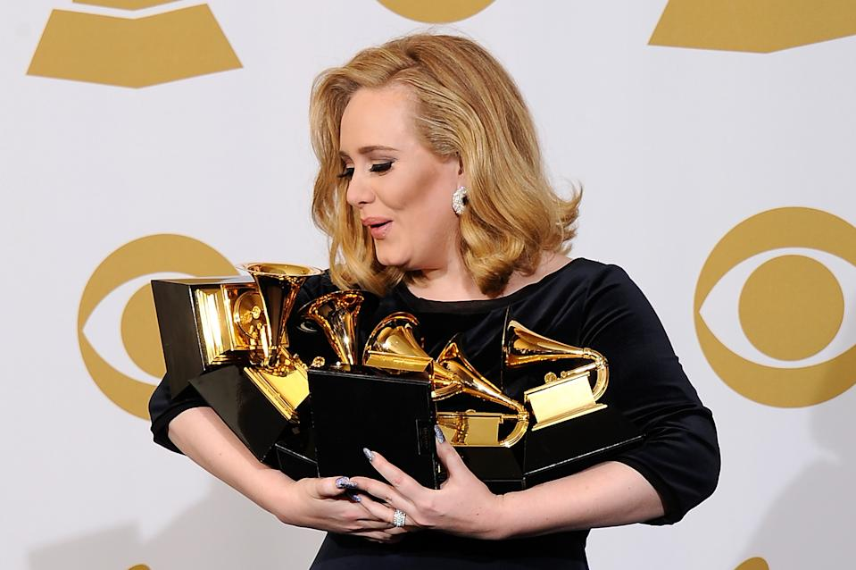 Adele pictured in 2012 with her Grammy awards for '21'. (Photo by Kevork Djansezian/Getty Images)