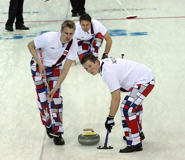 <p>Norway's curlers were somewhat subdued in their fashion selections for their Olympic match vs. the United States on Monday, Feb. 10, 2014, in Sochi, Russia, but their pants still stood out. (Tom Peterson/MCT via Getty Images) </p>