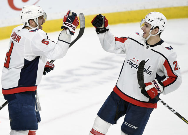 Washington Capitals' Alex Ovechkin (8), of Russia, and Garnet Hathaway (21) celebrate a 4-3 win against the Minnesota Wild following an NHL hockey game, Sunday, March 1, 2020, in St. Paul, Minn. (AP Photo/Hannah Foslien)