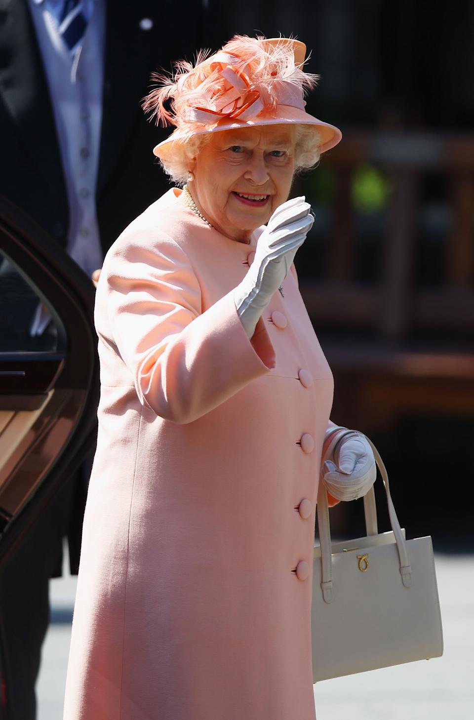 <p>It may have been a low-key event in royal terms, but the Queen gave a wave to those waiting to catch a glimpse. (Jeff J Mitchell/Getty Images)</p>