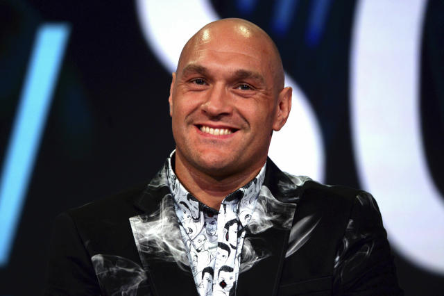 Britain's Tyson Fury smiles during a press conference at the BT Sport Studio, London, Monday May 13, 2019. British heavyweight Tyson Fury is preparing for his Las Vegas debut against Germany's Tom Schwarz on 15 June. (Kirsty O'Connor/PA via AP)
