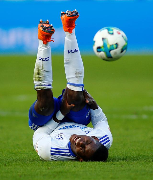 Soccer Football - Bundesliga - Bayer Leverkusen vs Schalke 04 - BayArena, Leverkusen, Germany - February 25, 2018 Schalke's Breel Embolo after sustaining an injury from a challenge by Bayer Leverkusen's Dominik Kohr for which the Leverkusen player was sent off REUTERS/Thilo Schmuelgen DFL RULES TO LIMIT THE ONLINE USAGE DURING MATCH TIME TO 15 PICTURES PER GAME. IMAGE SEQUENCES TO SIMULATE VIDEO IS NOT ALLOWED AT ANY TIME. FOR FURTHER QUERIES PLEASE CONTACT DFL DIRECTLY AT + 49 69 650050