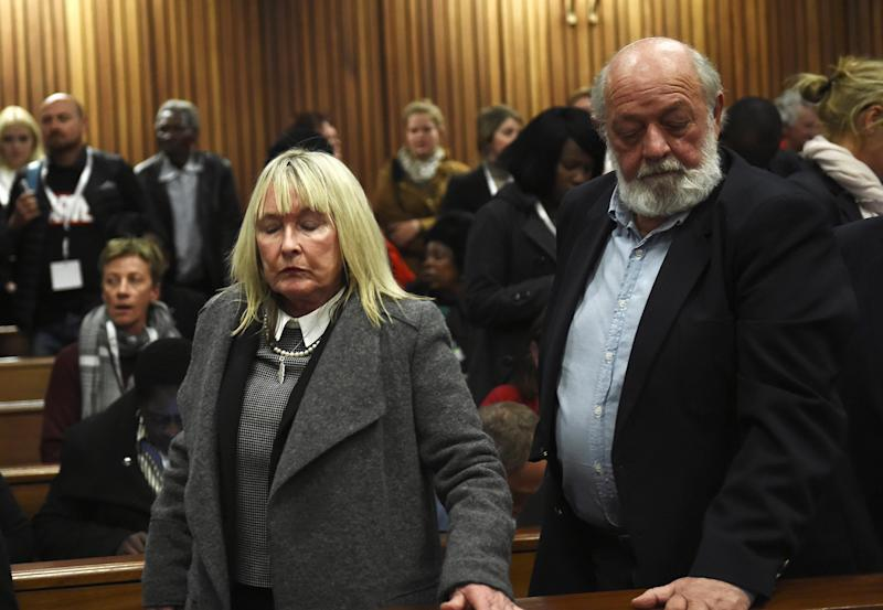June and Barry Steenkamp react after the sentence hearing of Olympic and Paralympic track star Oscar Pistorius at the North Gauteng High Court in Pretoria