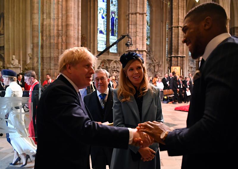 LONDON, ENGLAND - MARCH 09: Britain's Prime Minister Boris Johnson and his fiancee partner Carrie Symonds talk with British boxer Anthony Joshua as they leave after attending the Commonwealth Day Service 2020 on March 9, 2020 in London, England. (Photo by Ben Stansall-WPA Pool/Getty Images)