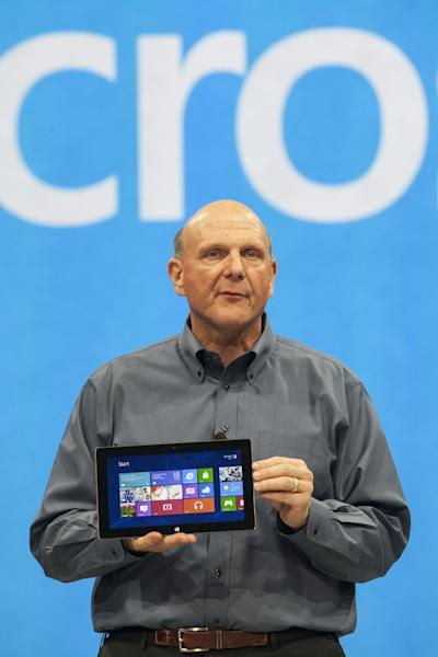 """Microsoft CEO Steve Ballmer unveils """"Surface"""", a new tablet computer to compete with Apple's iPad at Hollywood's Milk Studios in Los Angeles Monday, June 18, 2012. The 9.3 millimeter thick tablet comes with a kickstand to hold it upright and keyboard that is part of the device's cover. It weighs under 1.5 pounds. (AP Photo/Damian Dovarganes)"""