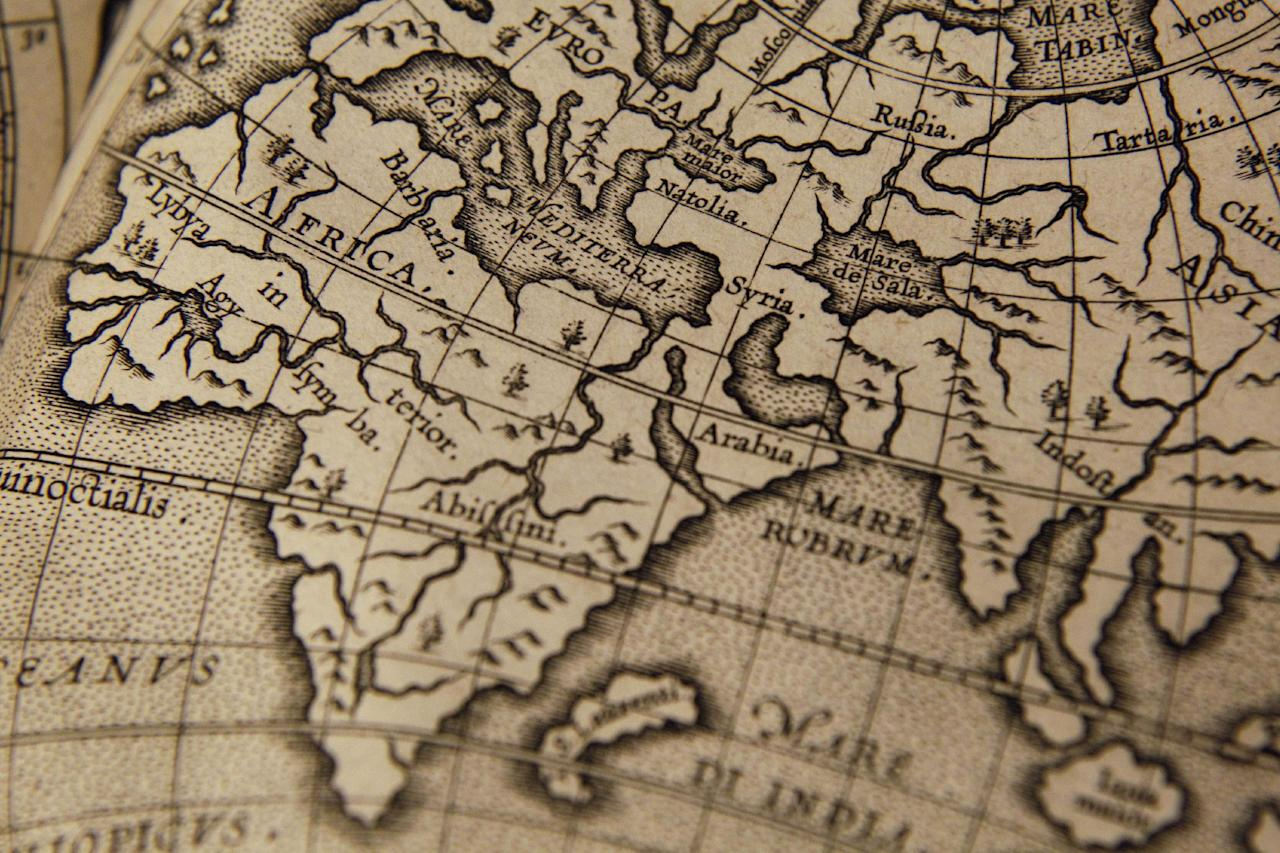 The a detail of a world map page of the Wytfliet Atlas is photographed during a news conference, Wednesday, June 27, 2012 in New York. The Wytfliet Atlas stolen a decade ago from the Royal Library of Sweden has been recovered in New York. (AP Photo/Mary Altaffer)