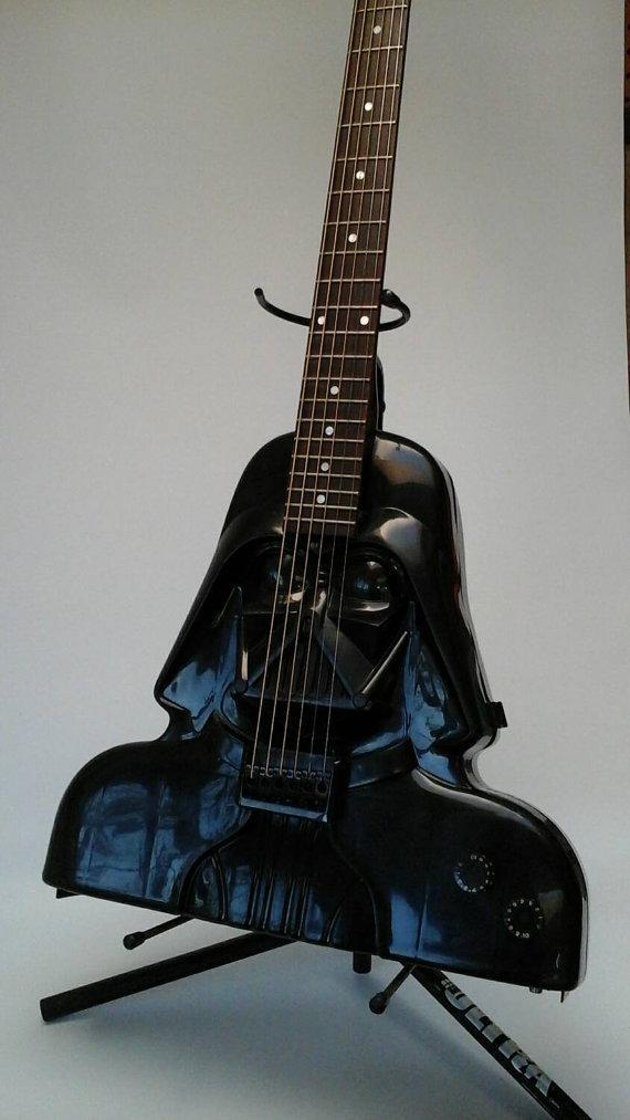 """<p>Why wield a light saber when you can pick up, you know, an <i>axe?</i> A couple of the guitar artisans on Etsy have handcrafted <i>Star Wars</i>-themed six-strings. This one uses the helmet head of the late Lord Vader as a body. Get it <a href=""""https://www.etsy.com/listing/86381203/darth-vader-star-wars-electric-acoustic?ref=listing-shop-header-0"""" rel=""""nofollow noopener"""" target=""""_blank"""" data-ylk=""""slk:HERE"""" class=""""link rapid-noclick-resp"""">HERE</a>.<br></p>"""