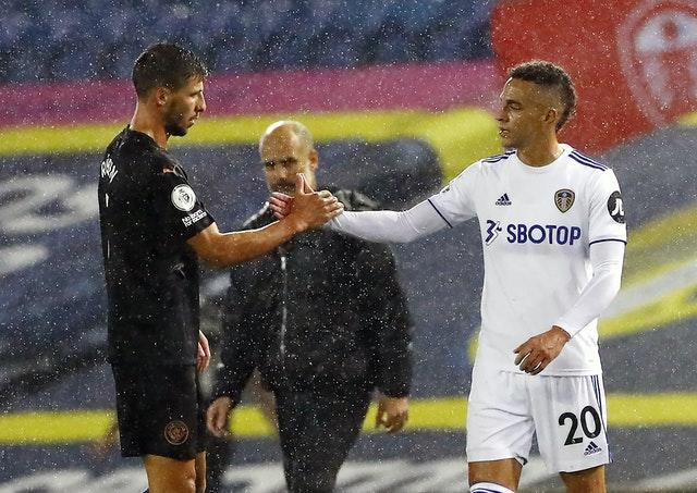 New Manchester City defender Ruben Dias, left, and Leeds forward Rodrigo