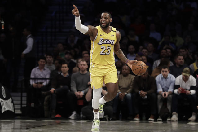 Los Angeles Lakers' LeBron James (23) calls out to his teammates during the first half of an NBA basketball game against the Brooklyn Nets Thursday, Jan. 23, 2020, in New York. (AP Photo/Frank Franklin II)
