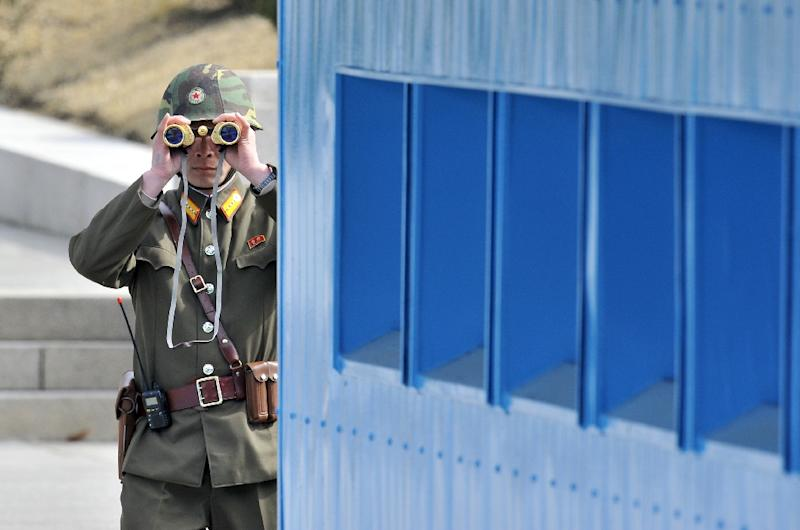 A North Koreas soldier at the truce village of Panmunjom, in the demilitarized zone dividing the Koreas peninsula (AFP Photo/Jung Yeon-Je)
