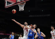 Iran's Hamed Haddadi (15) and Czech Republic's David Jelinek (25) fight for a rebound during men's basketball game at the 2020 Summer Olympics, Sunday, July 25, 2021, in Saitama, Japan. (AP Photo/Charlie Neibergall)