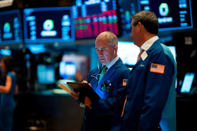 Traders work after the opening bell at the New York Stock Exchange (NYSE) on Wall Street on Aug. 1, 2019, in New York City.