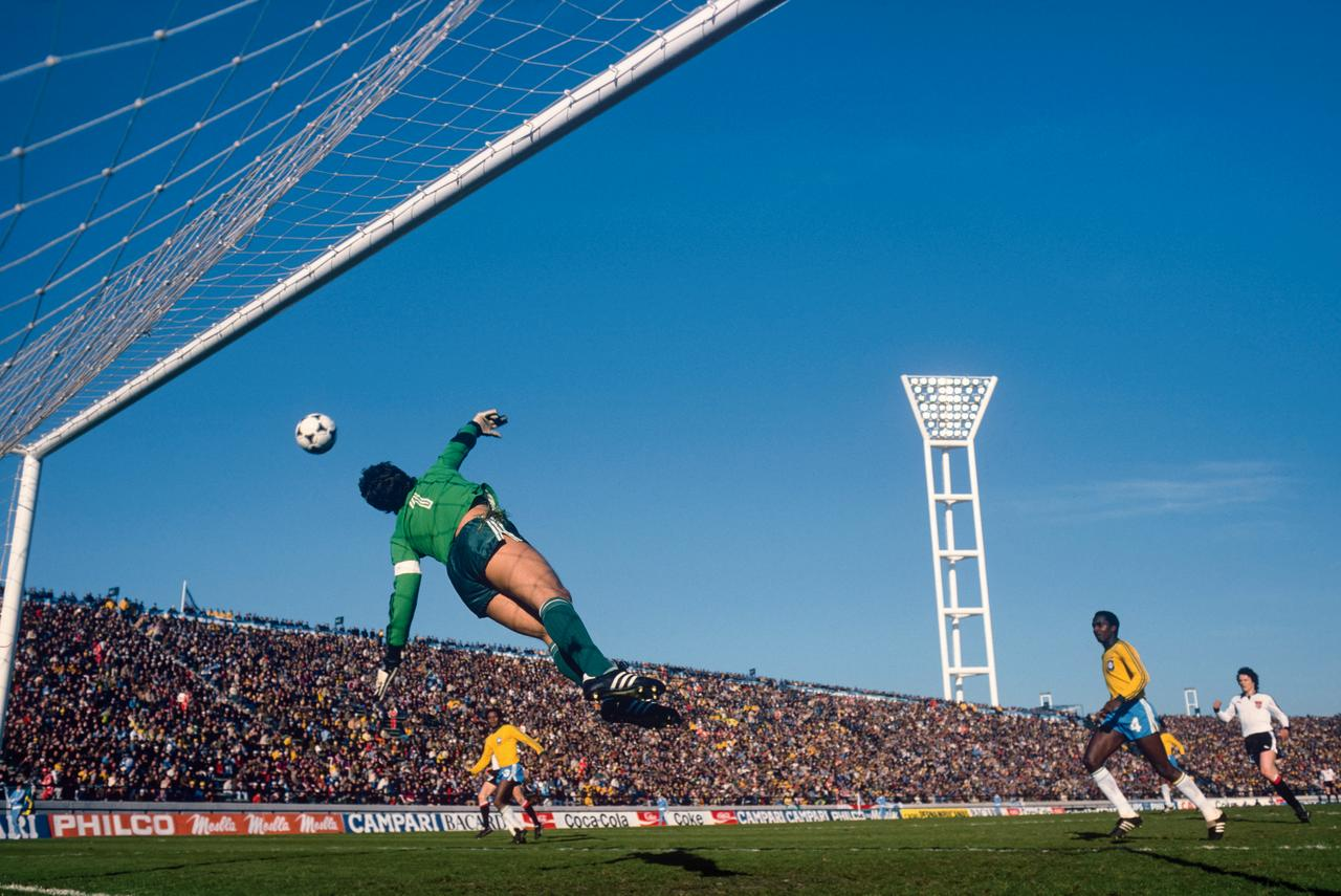 Émerson Leão, the Brazil goalkeeper, is airborne as a shot narrowly misses the target during his team's 1‒0 win over Austria.