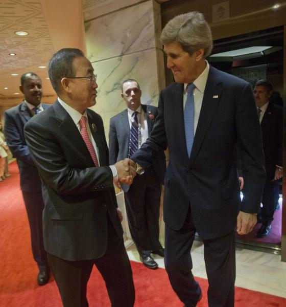 U.S. Secretary of State John Kerry, right, is greeted by UN Secretary General Ban Ki-Moon, left, before the start of their meeting at Bayan Palace in Kuwait City, Kuwait, Wednesday, Jan. 15, 2014. (AP Photo/Pablo Martinez Monsivais, Pool)