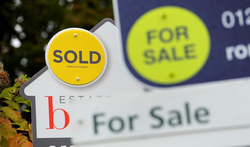 Embargoed to 0001 Thursday August 13 File photo dated 14/10/14 of estate agents signs. The UK housing market could be heading for a boom followed by a bust, according to feedback gathered by surveyors.