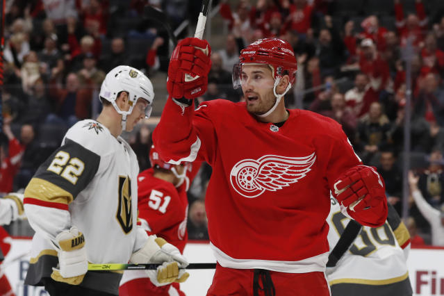 Detroit Red Wings left wing Brendan Perlini reacts after a goal by teammate center Andreas Athanasiou during the first period of an NHL hockey game against the Vegas Golden Knights, Sunday, Nov. 10, 2019, in Detroit. (AP Photo/Carlos Osorio)