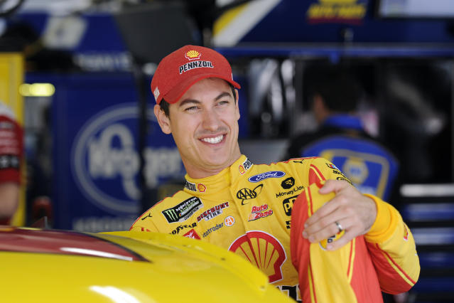 Joey Logano gets into his car to practice for Sunday's NASCAR Cup Series auto race at Charlotte Motor Speedway in Concord, N.C., Saturday, Sept. 28, 2019. (AP Photo/Mike McCarn)