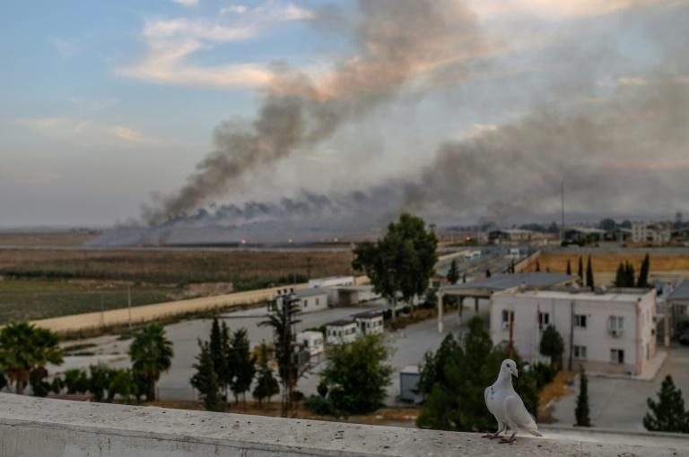 Smoke rises from the Syrian town of Tal Abyad, in a picture taken from the Turkish side of the border on October 10, 2019, on the second day of Turkey's military operation against Kurdish forces