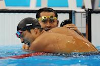 LONDON, ENGLAND - AUGUST 01: (L-R) Kosuke Kitajima of Japan and Ryo Tateishi of Japan celebrate after Tateishi finished third in the Final for the Men's 200m Breaststroke on Day 5 of the London 2012 Olympic Games at the Aquatics Centre on August 1, 2012 in London, England. (Photo by Mike Hewitt/Getty Images)