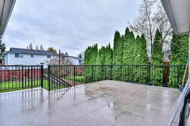 <p><span>8852 148 Street, Surrey, B.C.</span><br> There's plenty of space outside, as the home sits on a 7,200-square-foot lot, and has a fully-fenced backyard.<br> (Photo: Zoocasa) </p>